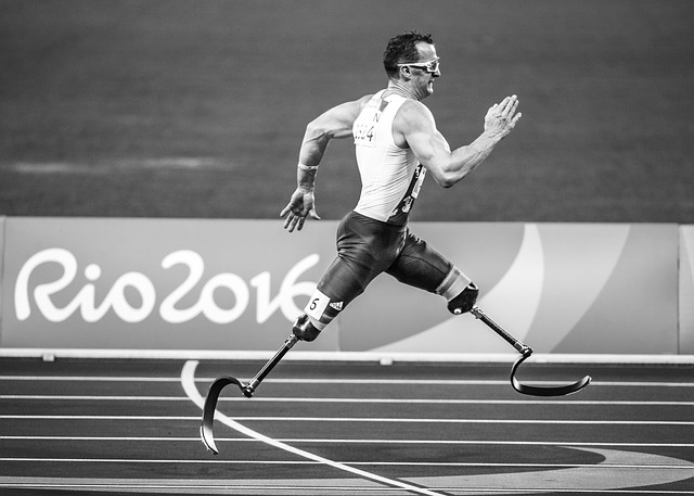 man with disability running in the olympics-discarding disability mindset