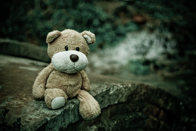 Teddy bear sitting representing childhood trauma